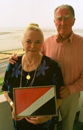 Roy Bates, with his wife, Joan, founded the Principality of Sealand in 1967. In her hands is an image of the Sealand flag.