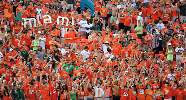 The University of Miami student section cheers on the Hurricanes against North Carolina.