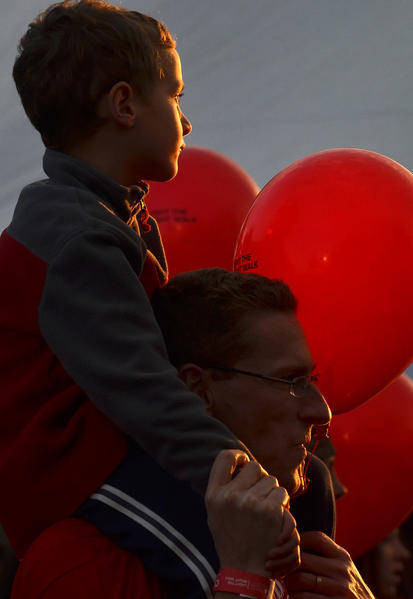 Lehigh Valley Restaurant Group team members father Van Eric Stein carries his son Henry Stein, 5, both of South Whitehall Township are surrounded by red balloon during the The Leukemia and Lymphoma Society's Light The Night Walk held at Northampton Community College on Saturday evening. Over 2,000 people participated in the event.