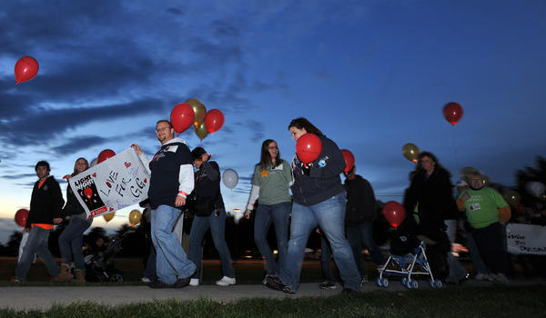 Friends and families walk in support of loved ones during the The Leukemia and Lymphoma Society's Light The Night Walk held at Northampton Community College on Saturday evening. Over 2,000 people participated in the event.