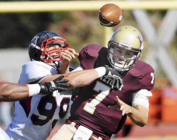 In Shippensburg University at Kutztown University college football Saturday Kutztown's quarterback Kevin Morton coughs up the ball during a hit by Shippensburg's Jake Metz.