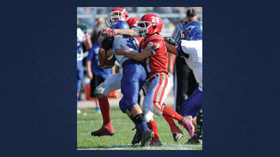 Rockwood¿s Joel Ansell, 27, and Logan Svonavec team up to mug Conemaugh Valley¿s freshman running back Brandon Galasso Saturday.