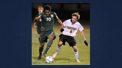 Somersets Ian Hicks battles for the ball with Preston Miller of North Star during varsity action Saturday. The Eagles defeated the Cougars, 3-1 (??). Hicks and five other Eagle seniors were recognized in a pre-game ceremony. See more action at davebreen.com.