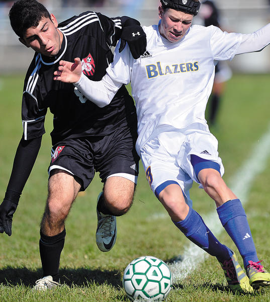 North Hagerstown's Yusuf Bodirov (left) and Clear Spring's Jonathan Henesy (right) muscle for position to get the ball during the Blazers' 2-0 victory to win the county tournament title.