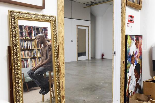 Michael Massenburg sits in his loft space in the Beacon Arts Building in Inglewood.