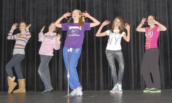 """From left, Elizabeth Hanwell, Erin McLamb, Kendall Emore, Abbey Sweeney and Jessica Hanwell rehearse a scene from """"Bugsy Malone Jr.,"""" the upcoming show from the Carroll Arts Center's Children's Theatre Troupe. The troupe will give a preview as part of the Carroll County Theatre Showcase on Oct. 19. The showcase will present vignettes from community theater groups around the county."""