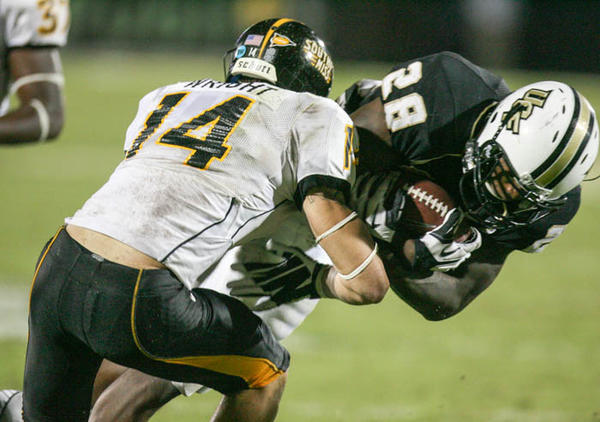 University of Central Florida running back Latavius Murray (28) runs for yardage during double overtime action of a C-USA football game against Southern Miss at the Brighthouse Networks Stadium on Saturday, October 13, 2012 in Orlando, FL.