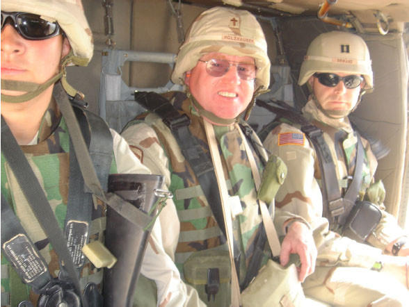 The Rev. Joe Holzhauser, center, is seen with other soldiers in Jalalabad, Afghanistan. Holzhauser was deployed for a yearlong tour in Afghanistan with a National Guard engineering unit from Rapid City in 2005. Photo courtesy of the Rev. Joe Holzhauser