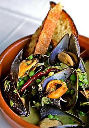 Mussels in white wine with new garlic and English peas.