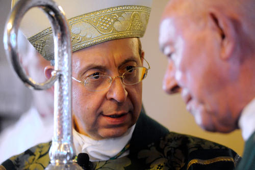 Archbishop William E. Lori of Baltimore, left, talks to Monsignor Paul Cook, pastor of St. Joseph Catholic Parish, before a Mass Saturday Oct. 13 at St. Joseph Catholic Parish in Cockeysville.