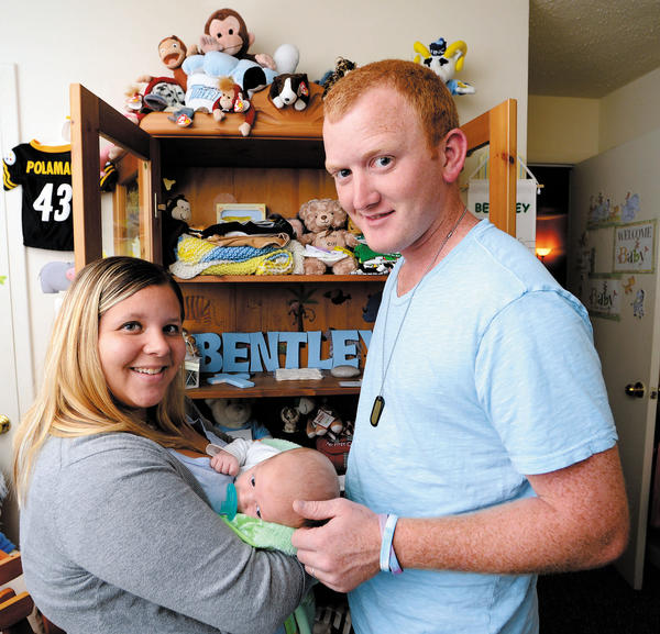 Stephanie and Blake Nalley of Hagerstown hold their 2-month-old son, Chase. The Nalleys have started a local chapter of Faces of Loss/Faces of Hope that offers support for those who experienced pregnancy or infant loss.