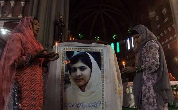 Pakistani Christians attend a mass praying for the recovery of child activist Malala Yousafzai