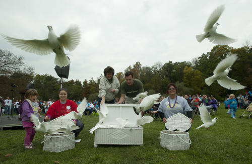 Brenda and Andy Loiacano of Nazareth (center) releases doves, as they are assisted by fellow board members of the The American Foundation for Suicide Prevention - Lehigh Valley Chapter, offcially launching the start of the Out of the Darkness Walk on Sunday at the Lehigh Parkway in Allentown.