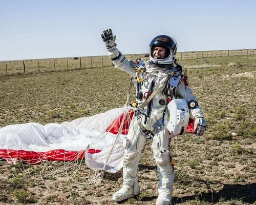 Pilot Felix Baumgartner of Austria celebrates after successfully completing the Red Bull Stratos flight in Roswell, N.M.