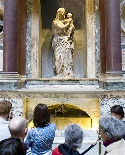 Tourists view the tomb of artist Raphael at the Pantheon in Rome
