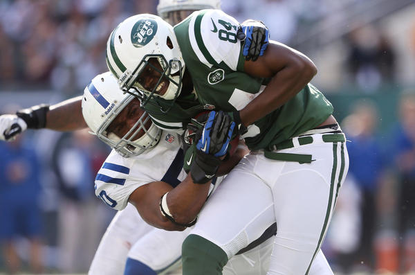 Stephen Hill #84 of the New York Jets is tackled by Jerrell Freeman #50 of the Indianapolis Colts at MetLife Stadium on October 14, 2012 in East Rutherford, New Jersey. NY Jets won 35–9.