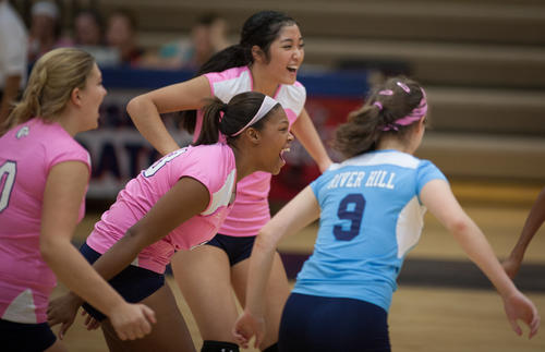 River Hill's Taylor Thomas, center, screams in celebration with her teammates after a big score on Severna Park.