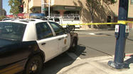 SAN DIEGO - A San Diego police officer shot a man armed with a handgun and military-style assault rifle in the corridor of an apartment building near Horton Plaza on Sunday.