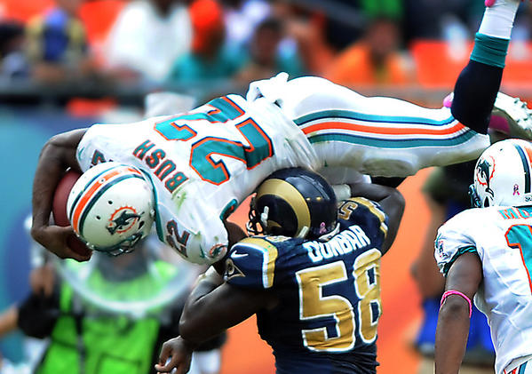 Miami's Reggie Bush gets up high on a fourth quarter run.
