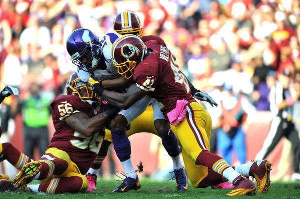 Percy Harvin #12 of the Washington Redskins runs the ball against the Minnesota Vikings at FedExField on October 14, 2012 in Landover, Maryland. Washington won 38–26.