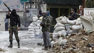 Syrian government troops regained control of a historic mosque in Aleppo after pushing rebel troops back from the area, a human rights group reported Sunday.
