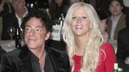 Appearing at a Paul Reed Smith Guitars benefit for the Johns Hopkins Kimmel Cancer Center, Journey guitarist Neal Schon surprised the audience by getting down on one knee and proposing -- on stage -- to Michaele Salahi.