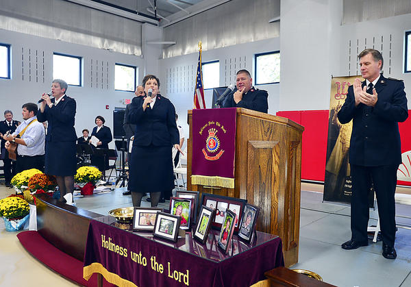 Members of the Salvation Army sing a song of praise during the dedication ceremony of the new Shifler Family Community Center on George Street in Hagerstown on Sunday.