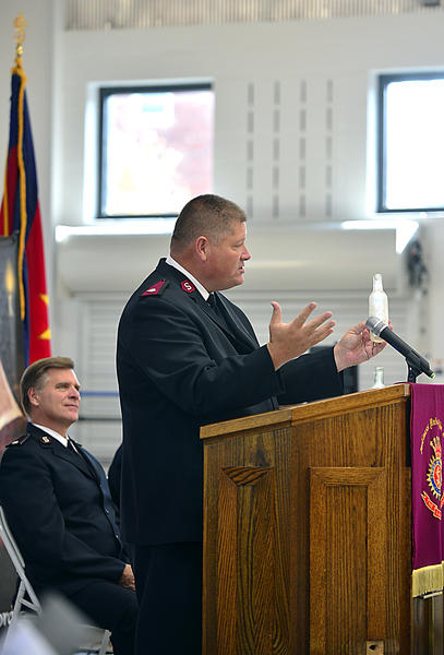 During the dedication ceremony of the new Shifler Family Community Center on George Street in Hagerstown on Sunday, Salvation Army Major Robert Lyle holds onto a glass bottle found in what was an old dumping ground that has now been turned into a playground to remind people that from the ashes new dreams can be made.