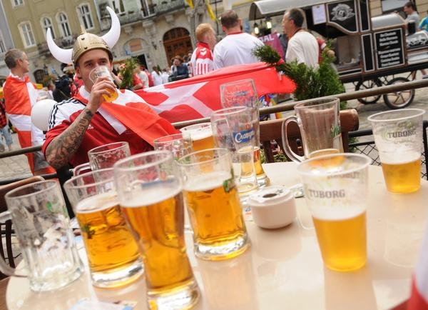 Danish fans drink beer and sing in Lviv as they wait for the start of the Group B Denmark vs Portugal match at the Euro 2012 football championships.