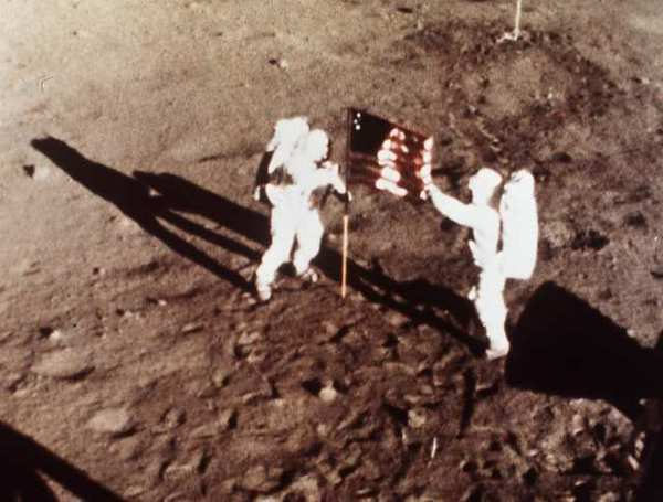 Neil Armstrong and Buzz Aldrin on the moon, July 20, 1969. Scientists are studying soils retrieved during Apollo missions to understand the origin of the moon's water.