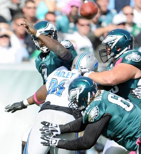 Eagles quarterback Michael Vick gets a pass off as he is hit by Lions defensive tackle Nick Fairley.
