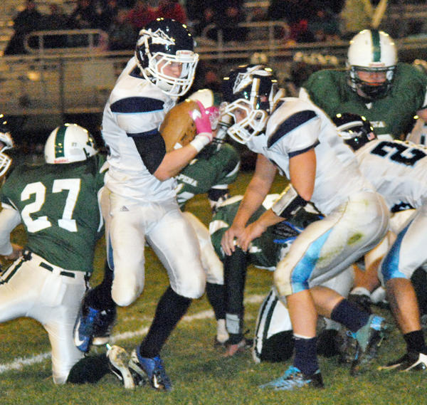Petoskey senior Tony DeAgostino (second from left) eludes the tackle of Alpena's Cade MacArthur during Friday's Big North Conference contest in Alpena. DeAgostino had a pair of touchdowns as the Northmen defeated the Wildcats, 28-7, to improve to 5-3 overall, 3-3 league.