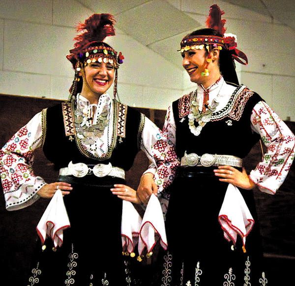 Rachel Powell, left, is shown with Sonja Capuzzi in Bulgarian costume. They will perform Sunday, Oct. 28, with the Tamburitzans dance group at Weinberg Center for the Arts in Frederick, Md.