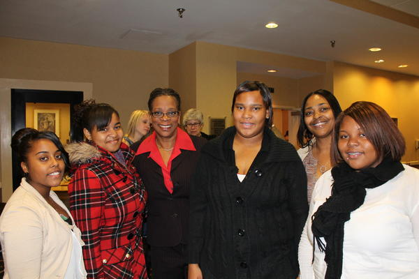State Treasurer Denise L. Nappier, third from left, with Peace Builders Youth and youth support specialist Tammy Young, second from right.