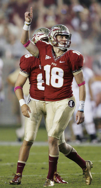 FSU kicker Dustin Hopkins points in celebration after kicking a field goal during the Boston College at Florida State University football game at Doak Campbell Stadium in Tallahassee on Saturday, October 13, 2012. The kick gave Hopkins the all-time FSU and ACC points record.