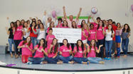 Wellington Community High School's thinkPINKkids Club recently gave a $13,000 check to Scripps, which is money that 13 clubs across Palm Beach County raised through events.