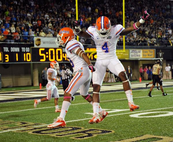 Solomon Patton #83 and Kyle Christy #4 of the Florida Gators celebrate a play against the Vanderbilt Commodores at Vanderbilt Stadium on October 13, 2012 in Nashville, Tennessee.