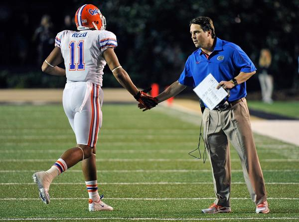 Head coach Will Muschamp of the Florida Gators greets Jordan Reed #11 as he leaves the field against the Vanderbilt Commodores at Vanderbilt Stadium on October 13, 2012 in Nashville, Tennessee.