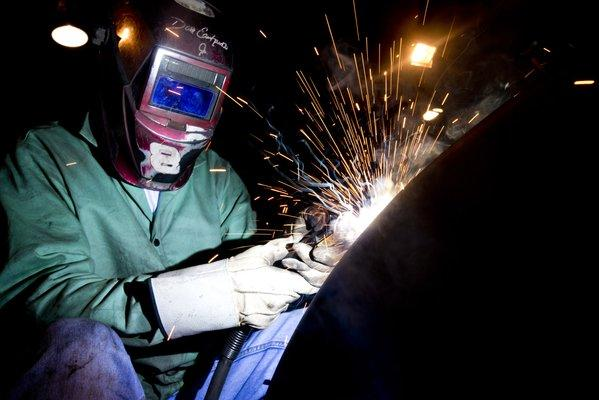 A welder builds parts for finished petroleum tanks at Southern Tank and Manufacturing Inc. in Kentucky.