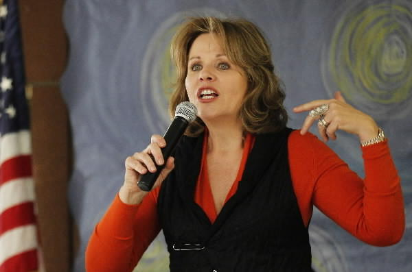 Singer Renee Fleming practices musical selections for a performance at Manuel Perez Jr. Elementary School in Chicago's Pilsen neighborhood on Monday. Fleming joined cellist Yo-Yo Ma and retired dancer Damian Woetzel at a program as the city released the Chicago Cultural Plan 2012.