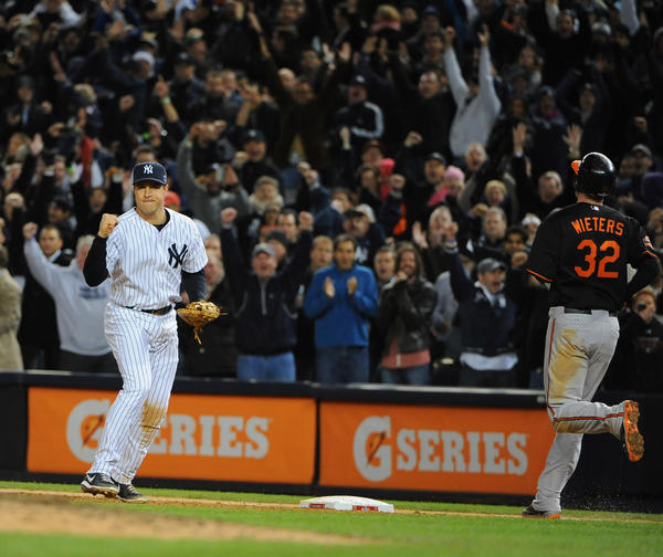 Yankees' Mark Teixeira, left, pumps his fist to celebrate after putting out Orioles' Matt Wieters, right, at first base to end the ALDS. The Yankees defeated the Orioles by score of 3 to 1 in game five of the ALDS at Yankees Stadium.