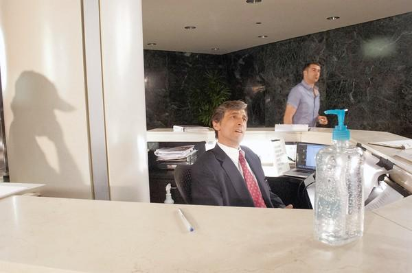 Actor David Pasquesi talks with the directors before a shoot called 'Graveyard' at an office building in Downers Grove.