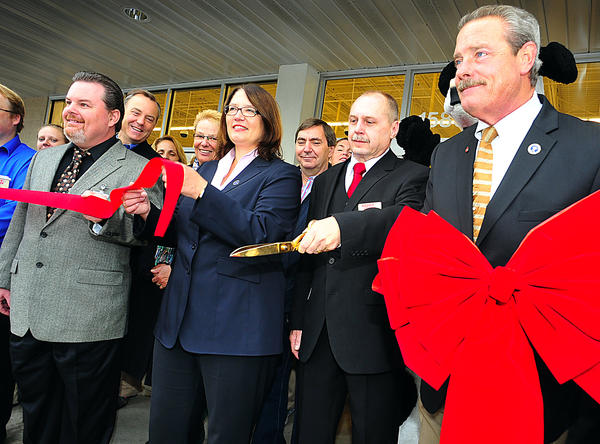 A new Hobby Lobby opened Monday with a ribbon-cutting ceremony. From left, Hobby Lobby District Manager Troy Moore, visiting Wesel Germany Burgermeisterin Ulrike Westkamp, Hobby Lobby Store Manager Nate Longworth and Hagerstown Mayor Robert E. Bruchey II.