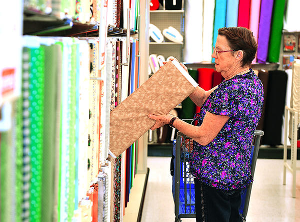 Patsy Rothen of Hagerstown scours the fabric aisles Monday on opening day of Hobby Lobby. She said she was the first customer in the fabrics area. Hobby Lobby held a ribbon cutting to formally open the store.