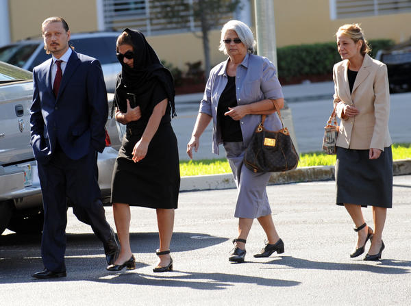 In this December 2011 photo, Donnie Eli, Rosie Marks, Rose Marks and Nancy Marks arrive at Federal Court in West Palm Beach for a hearing. They were released from house arrest pending trial on charges related to their alleged fortune telling endeavors. Mark Randall, South Florida Sun Sentinel