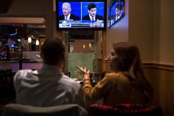 A couple is seen watching the Vice Presidential debate at a Washington D.C. restaurant.