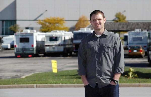 Jon Peacock, lead pastor of Mission Church, stands Monday near the parking lot in Carol Stream where the church's 32-foot equipment trailer was stolen. The nondenominational church meets at a Bloomingdale middle school gym.
