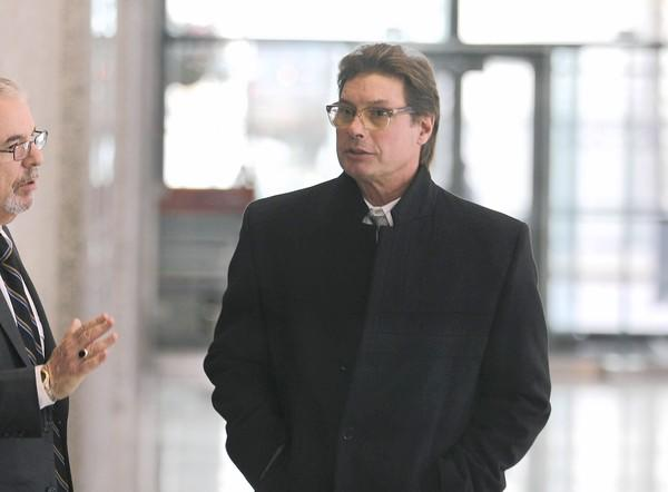 Michael DiFoggio, a Bridgeport developer who wore a wire on former Cook County Commissioner Joseph Moreno, leaves Dirksen U.S. Courthouse after pleading guilty to a tax charge Monday.