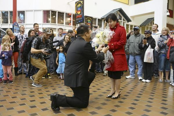"Alfred Chu proposes to Jennifer Tran after a flash mob danced to the song ""Yellow"" by the band Coldplay at Navy Pier Sunday."