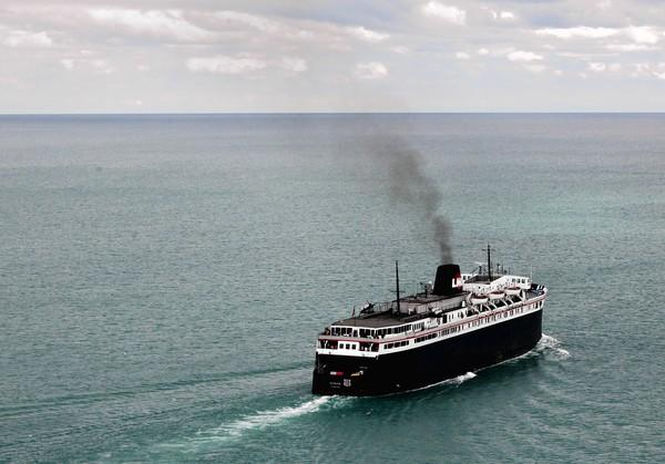 From spring to fall the S.S. Badger shuttles between Wisconsin and Michigan, spilling 4 tons of coal ash into Lake Michigan each trip.